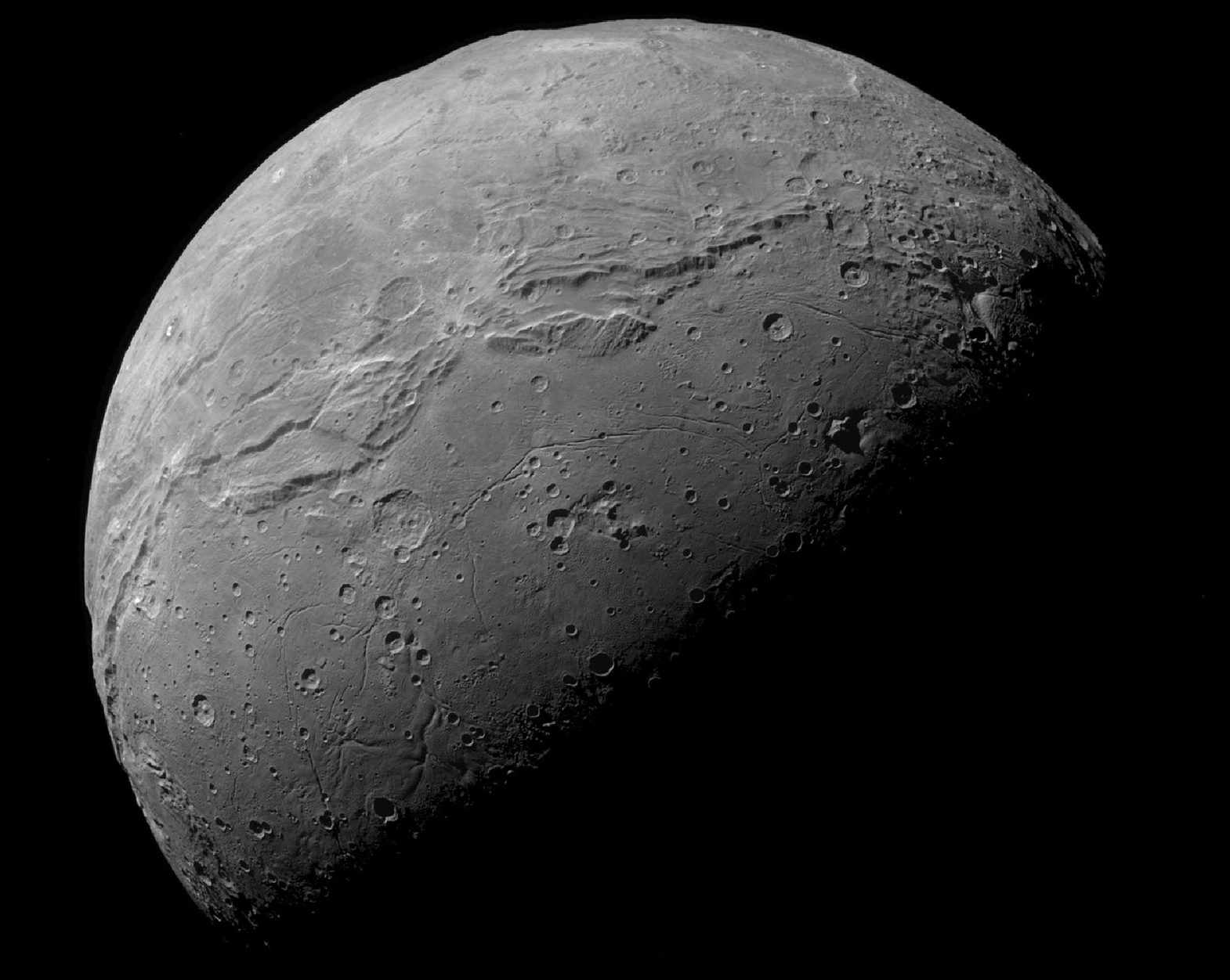 Pluto's moon Charon has a clear divide between its northern and southern hemispheres, marked by a line of ridges. Photo Credit: NASA/Johns Hopkins University Applied Physics Laboratory/Southwest Research Institute