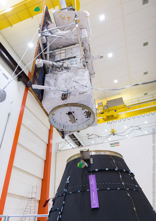 PRISMA being integrated to a payload adapter before launch. Photo Credit: Arianespace