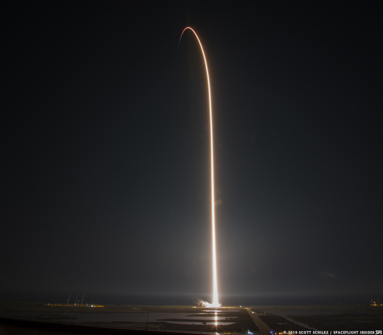 A long exposure image showing a launch streak for SpaceX's Crew Dragon atop a Falcon 9. Photo Credit: Scott Schilke / SpaceFlight Insider