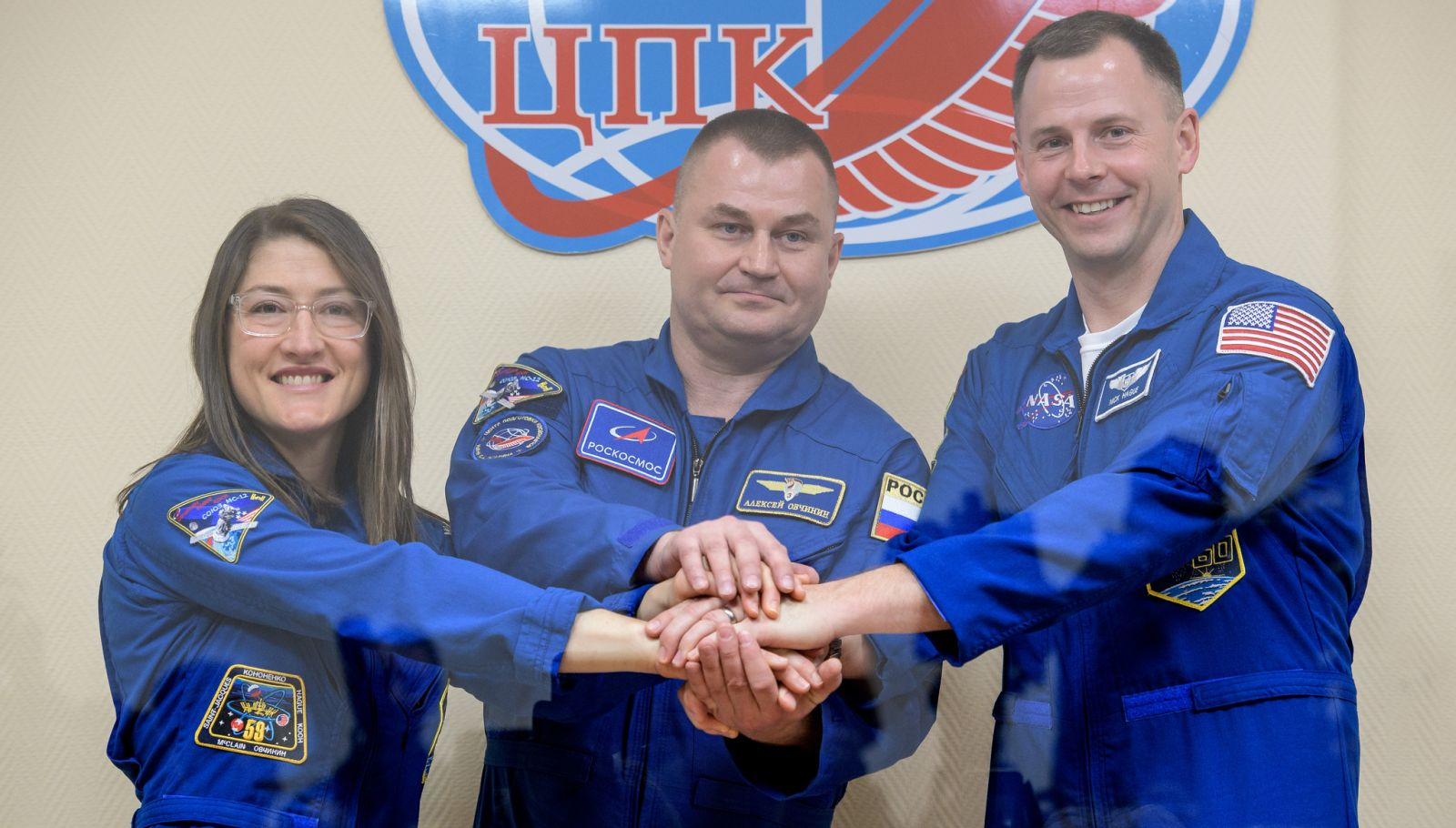 Soyuz MS-12 crew at the end of a pre-launch press conference on March 13, 2019. Photo Credit: Bill Ingalls / NASA