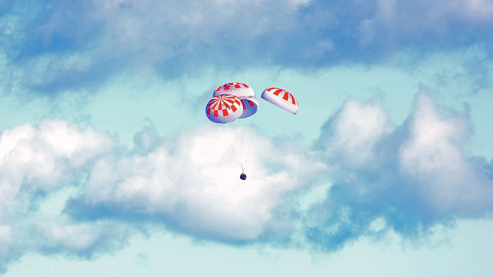 Crew Dragon descends under parachutes toward a splashdown in the Atlantic Ocean. Photo Credit: NASA