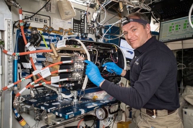 Canadian Space Agency astronaut David Saint-Jacques works to replace a part on the Combustion Integration Rack. Photo Credit: NASA