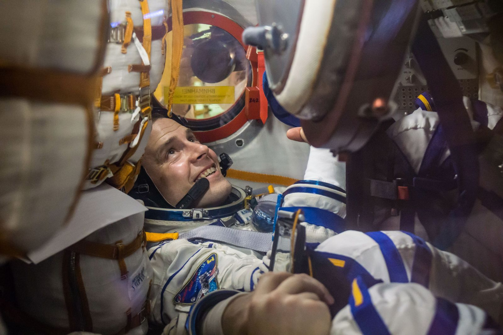 Nick Hague works inside Soyuz MS-12 during pre-launch training on Feb. 27, 2019. Photo Credit: Victor Zelentsov / NASA