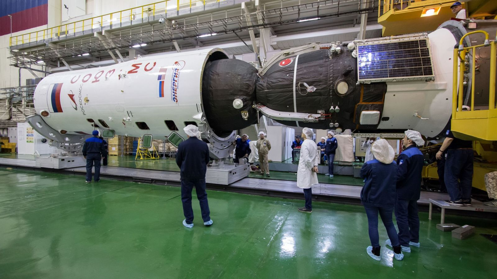 Soyuz MS-12 is encapsulated into a payload fairing before being attached to a Soyuz-FG rocket. Photo Credit: Victor Zelentsov / NASA