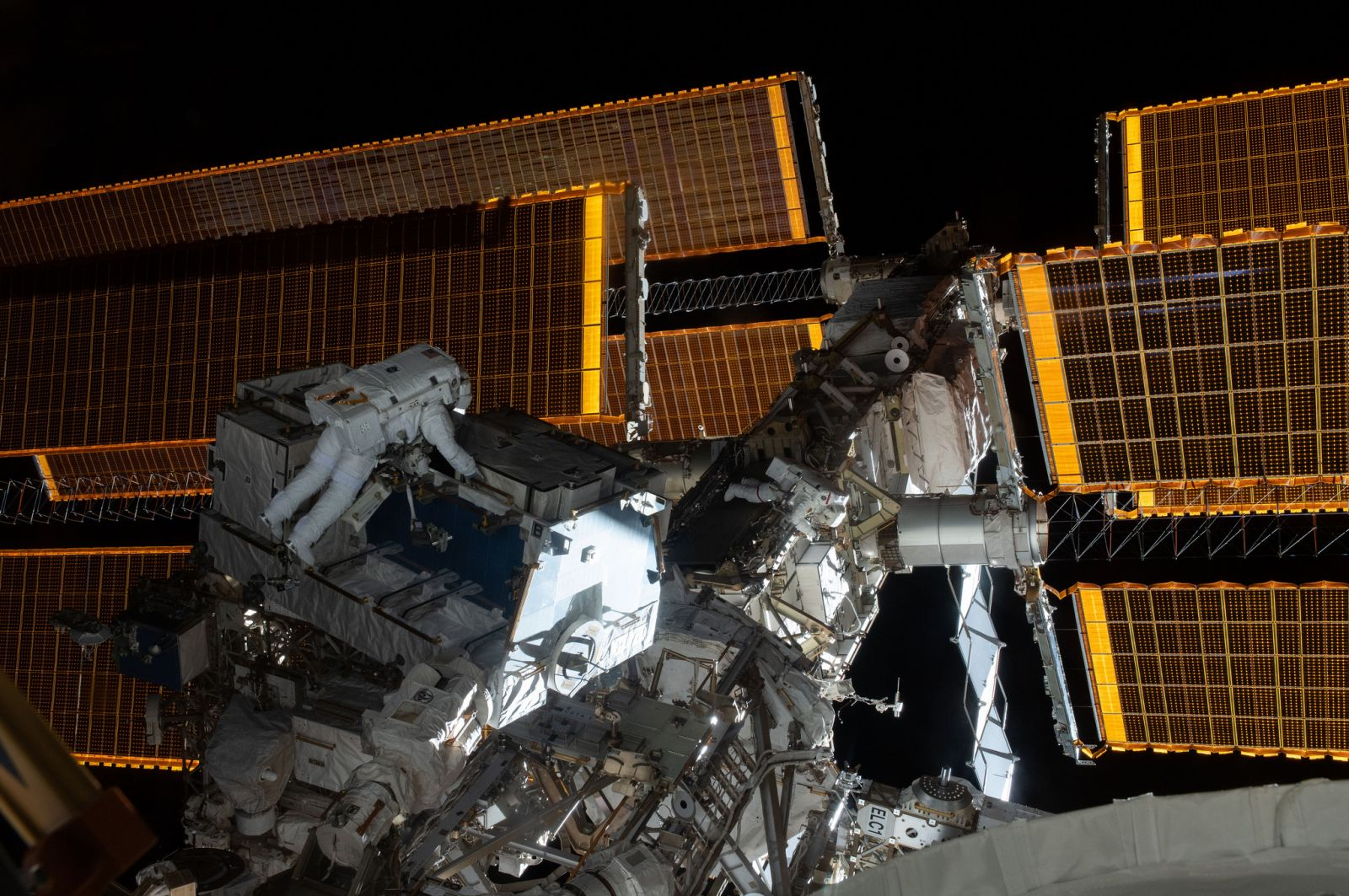 NASA astronauts Nick Hague, left, and Anne McClain work to replace batteries on the P4 truss. Photo Credit: NASA