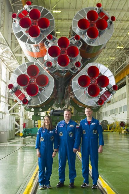 The Soyuz MS-12 crew in front of the Soyuz-FG rocket slated to send them into orbit on March 14, 2019. Photo Credit: Roscosmos