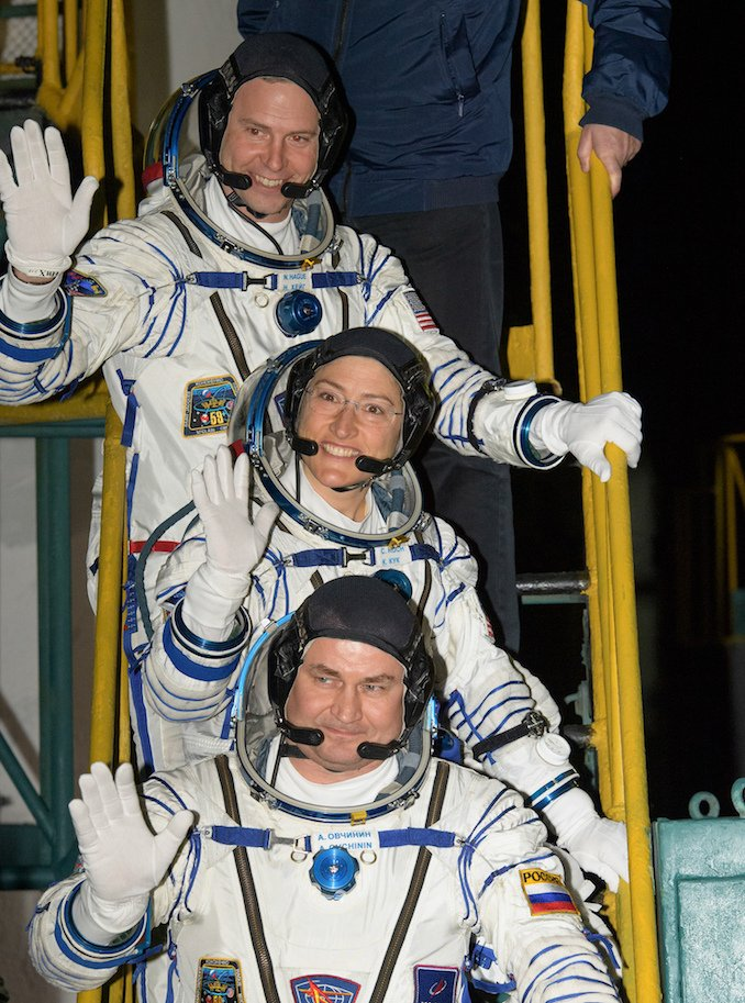 Hague, top, Koch, center, and Ovchinin wave goodbye to those present at the launch pad. Photo Credit: NASA