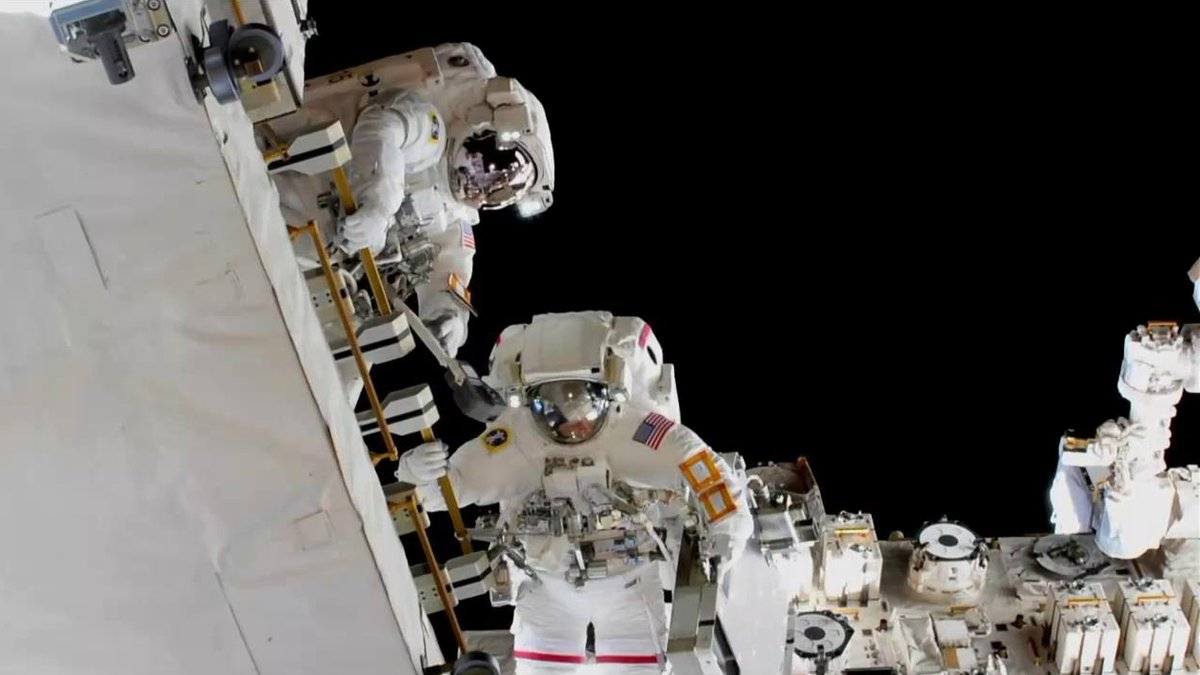 NASA astronauts Anne McClain, bottom, and Nick Hague work to install new lithium-ion batteries on the P4 truss segment. Photo Credit: NASA