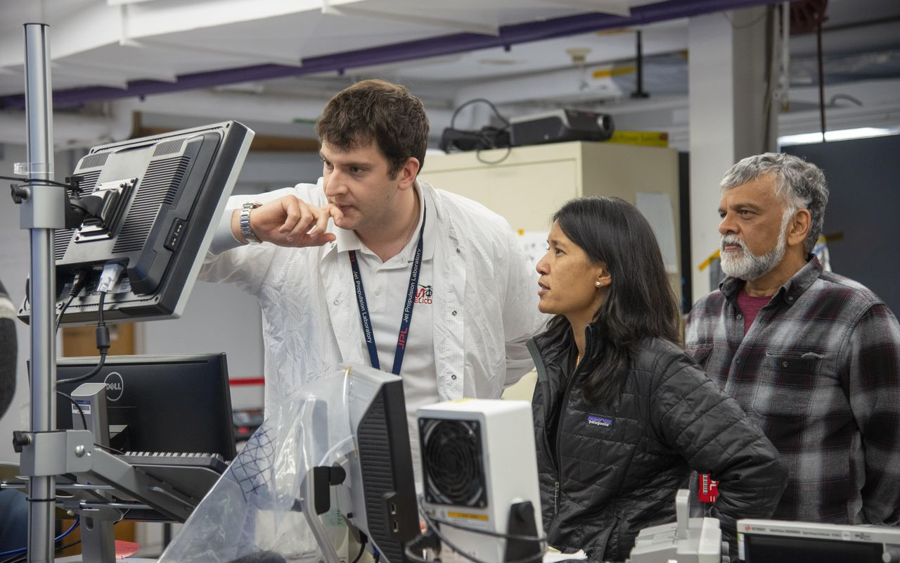 Teddy Tzanetos, MiMi Aung and Bob Balaram of NASA's Mars Helicopter project observe a flight test. The image was taken on Jan. 18, 2019 as the flight model of the Mars Helicopter was tested in the Space Simulator, a 25-foot-wide (7.62 meter-wide) vacuum chamber at NASA's Jet Propulsion Laboratory in Pasadena, California.Teddy Tzanetos, MiMi Aung and Bob Balaram of NASA's Mars Helicopter project observe a flight test. The image was taken on Jan. 18, 2019 as the flight model of the Mars Helicopter was tested in the Space Simulator, a 25-foot-wide (7.62 meter-wide) vacuum chamber at NASA's Jet Propulsion Laboratory in Pasadena, California. Photo Credit: NASA/JPL-Caltech