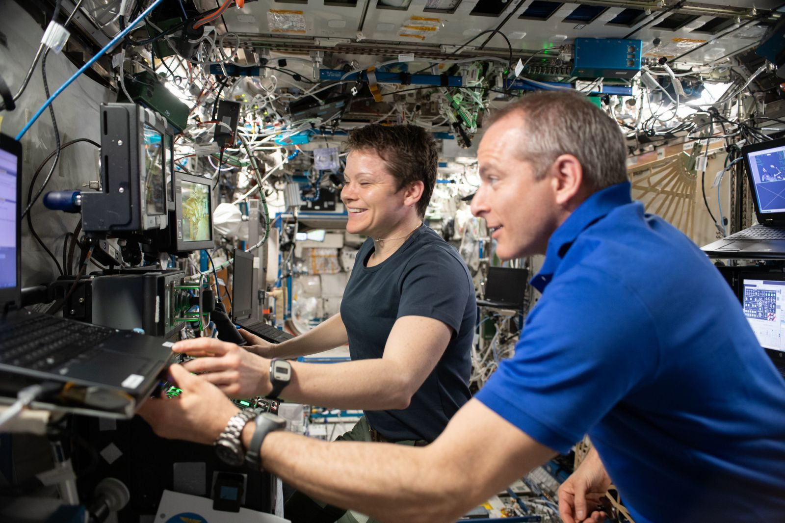 Expedition 59 astronauts Anne McClain and David Saint-Jacques of NASA and the Canadian Space Agency, respectively, practice Canadarm2 robotics maneuvers using the robotics workstation. in the Destiny module. Photo Credit: NASA