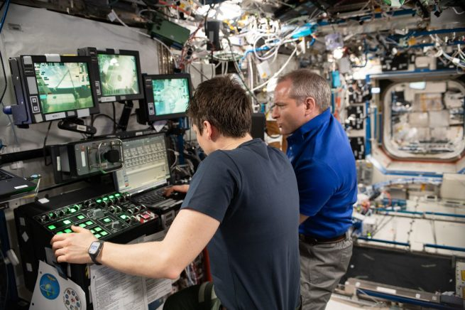 NASA astronaut Anne McClain and Canadian Space Agency astronaut David Saint-Jacques practice robotics maneuvers several days before the actual NG-11 Cygnus capture event. Photo Credit: NASA