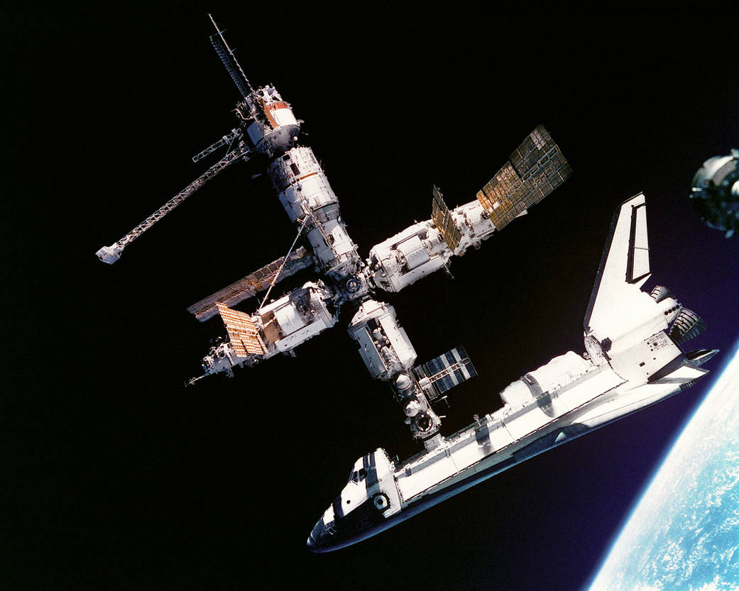 Space Shuttle Atlantis as seen docked with the Mir space station during STS-71 in June 1995. It was the first orbiter to dock with the Russian space station. Photo Credit: NASA