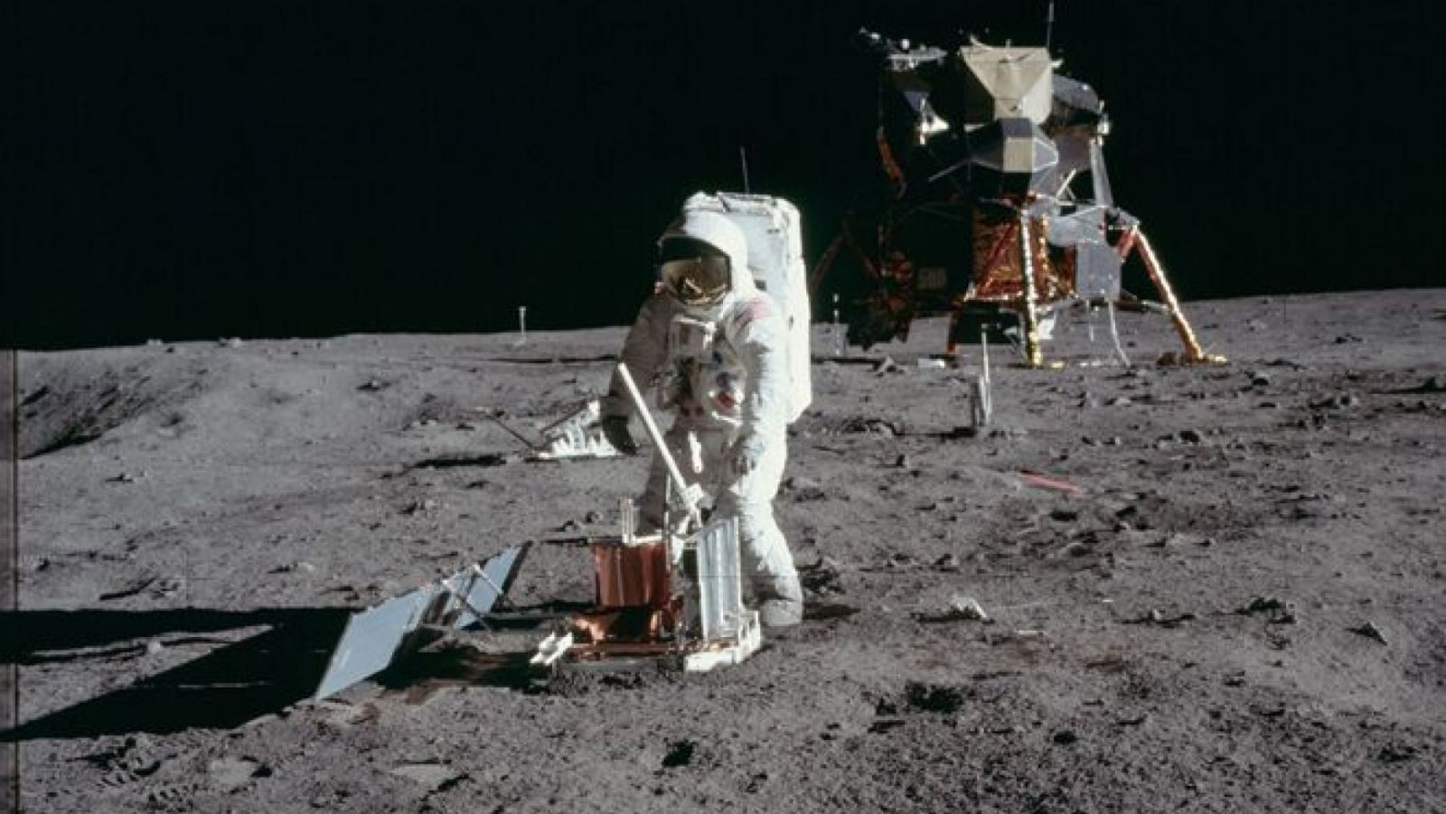 "Apollo 11's Command Module Pilot, Edwin ""Buzz"" Aldrin collects samples of the lunar soil after touching down on the Moon on July 20, 1969. Photo Credit: NASA"