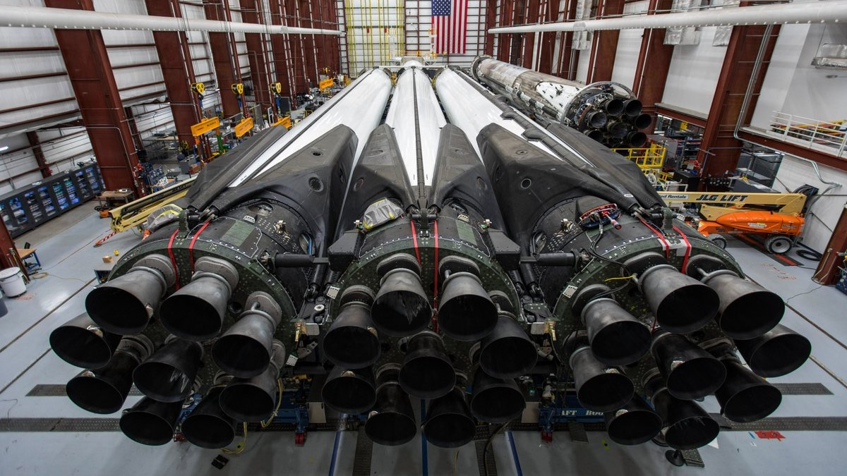 SpaceX readies its first Block 5 Falcon Heavy for flight inside the horizontal integration hangar just outside Kennedy Space Center's Launch Complex 39A