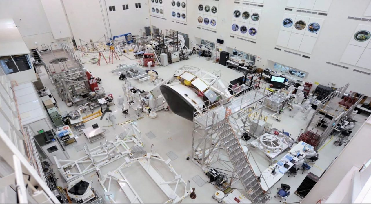 In the center of this image is the Mars 2020 spacecraft stack attached to the Spacecraft Assembly Rotation Fixture (SCARF) in the High Bay 1 clean room in JPL's Spacecraft Assembly Facility. Photo Credit: NASA/JPL-Caltech