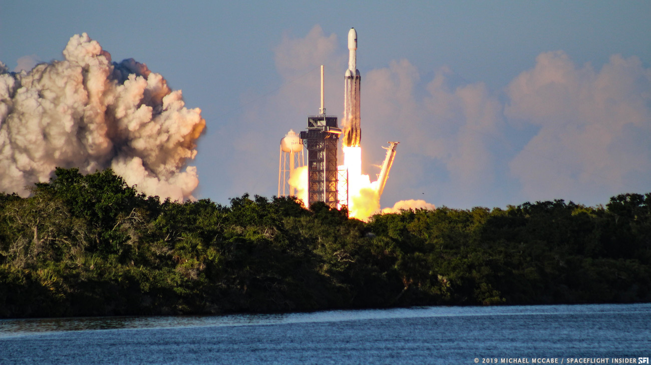 """The second flight of SpaceX's Falcon Heavy rocket saw all three first stage cores land - either at Cape Canaveral's Landing Zones 1 and 2 or out in the Atlantic on the """"Of Course I Still Love You"""" ASDS. Photo Credit: Michael John McCabe / SpaceFlight Insider"""