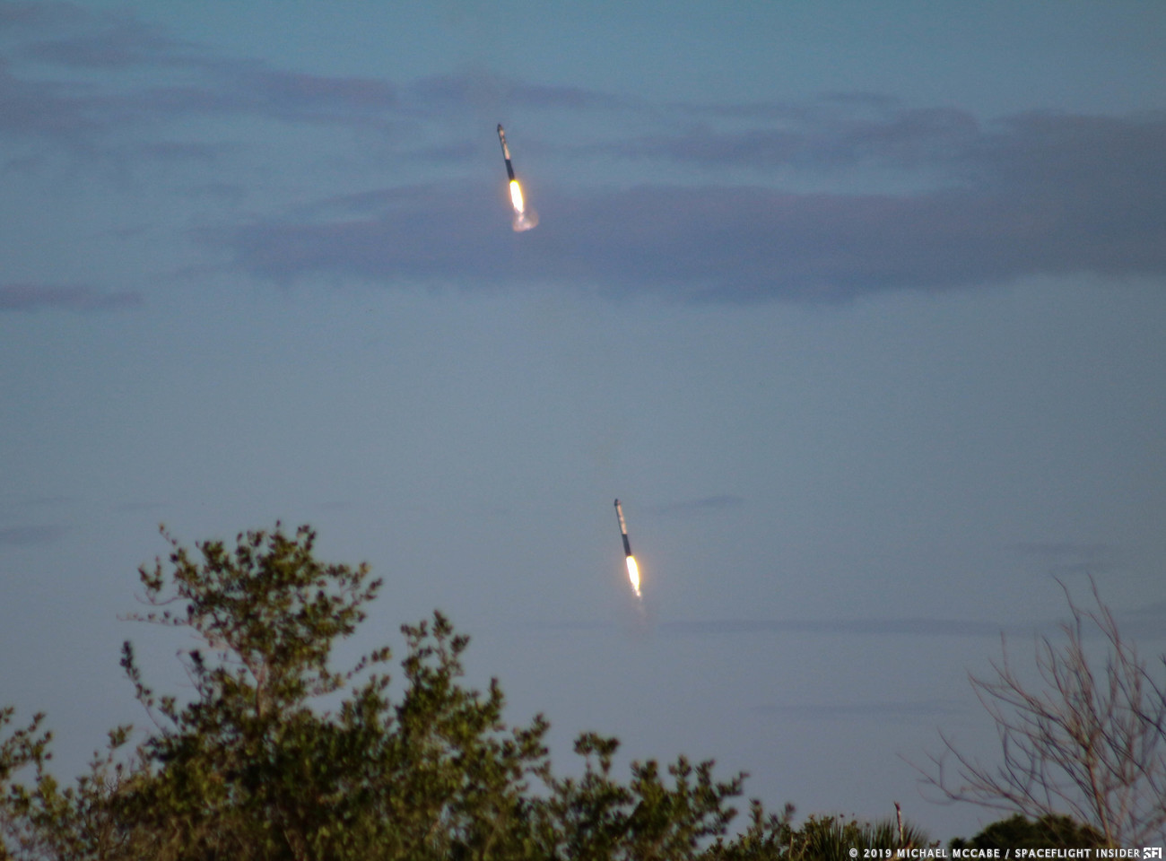 Two of the three booster cores used for Thursday's flight touch down at Canaveral's Landing Zones 1 and 2. Photo Credit: Michael McCabe / SpaceFlight Insider