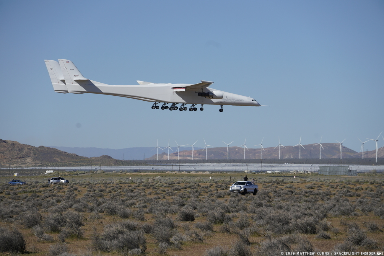 The Stratolaunch aircraft comes in for a landing after its first flight on Saturday, April 13, 2019. Photo Credit: Matthew Kuhns / SpaceFlight Insider