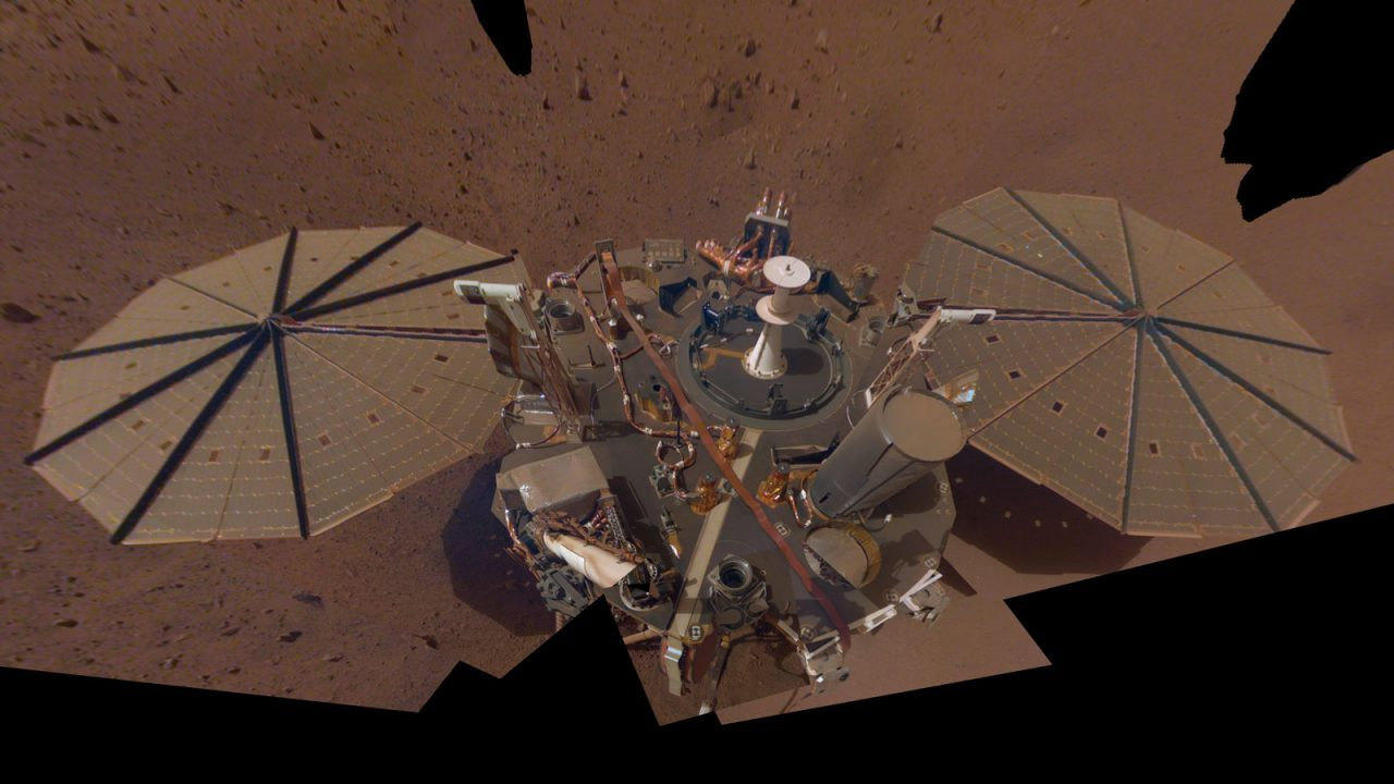 This is NASA InSight's second full selfie on Mars. Since taking its first, the lander has removed its heat probe and seismometer from its deck, placing them on the Martian surface; a thin coating of dust now covers the spacecraft as well. Image Credit: NASA/JPL_Caltech