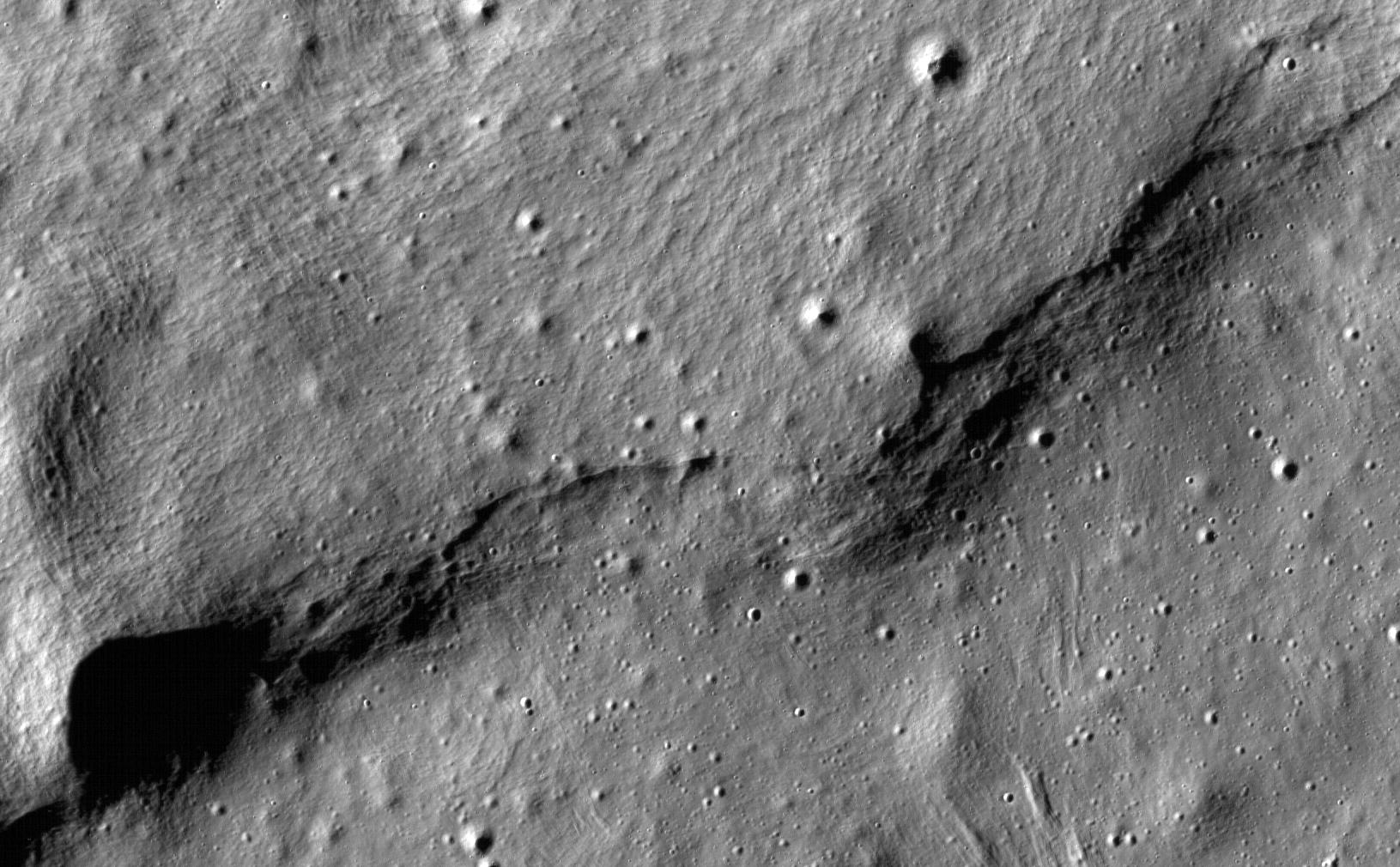 This image of lobate scarps, which is a kind of curved hill, was taken near a region of the Moon called Mare Frigoris by NASA's Lunar Reconnaissance Orbiter. It and other areas may show current tectonic activity on the Moon. Photo Credit: NASA