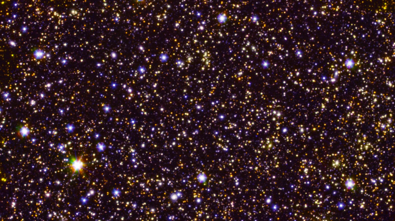 A deep-field view of the sky taken by NASA's Spitzer Space Telescope shows many faint, distant galaxies. Photo Credit: NASA/JPL-Caltech/ESA/Spitzer/P. Oesch/S. De Barros/I.Labbe