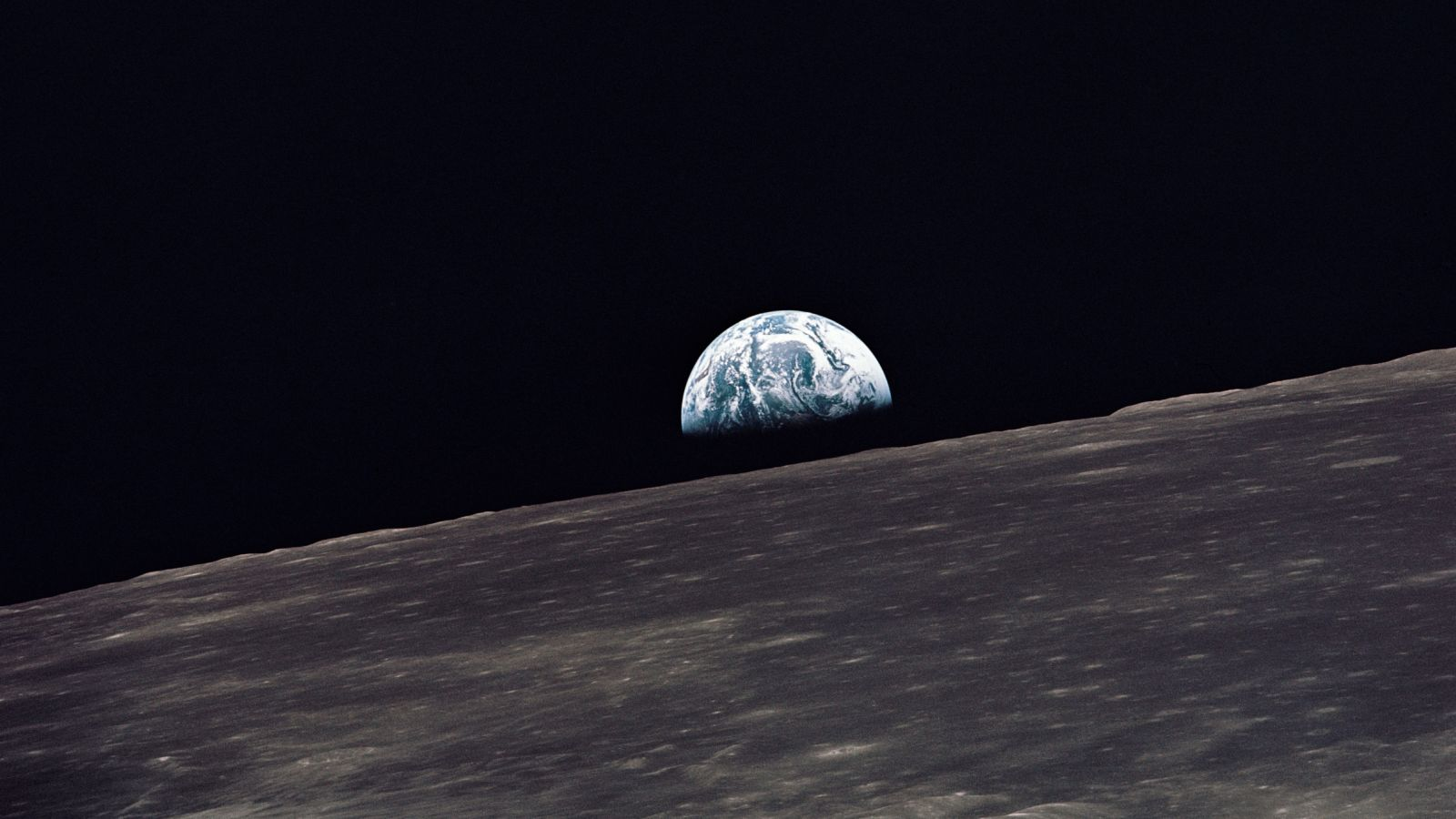 Earthrise as seen by the crew of Apollo 10 while orbiting the Moon. Photo Credit: NASA