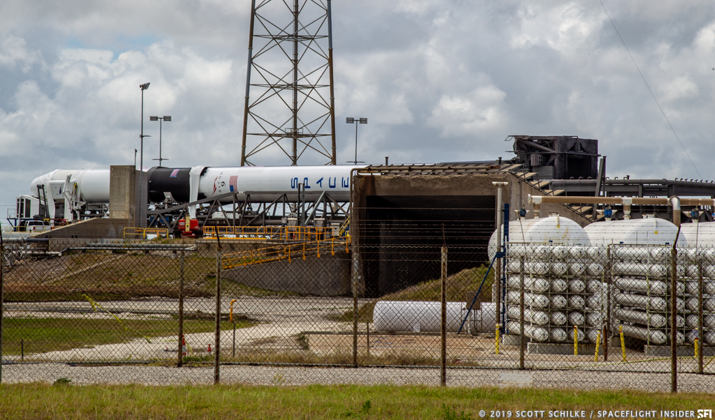 The Falcon 9 with CRS-17 before being raised to the vertical position in the hours before its May 3 launch attempt. Photo Credit: Scott Schilke / SpaceFlight Insider