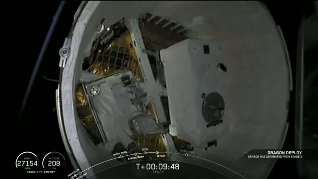 A view inside the trunk of the CRS-17 Dragon. There you can see the two external experiments being transported to the space station: The Orbiting Carbon Observatory-3, right, and Space Test Program-Houston 6. Photo Credit: SpaceX