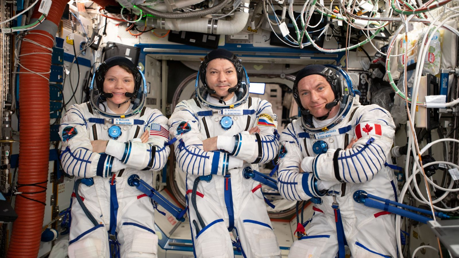 NASA's Anne McClain, left, Russia's Oleg Kononenko, center, and Canadian Space Agency astronaut David Saint-Jacques in their Sokol launch and entry suits aboard the ISS several days before their departure in Soyuz MS-11. Photo Credit: NASA