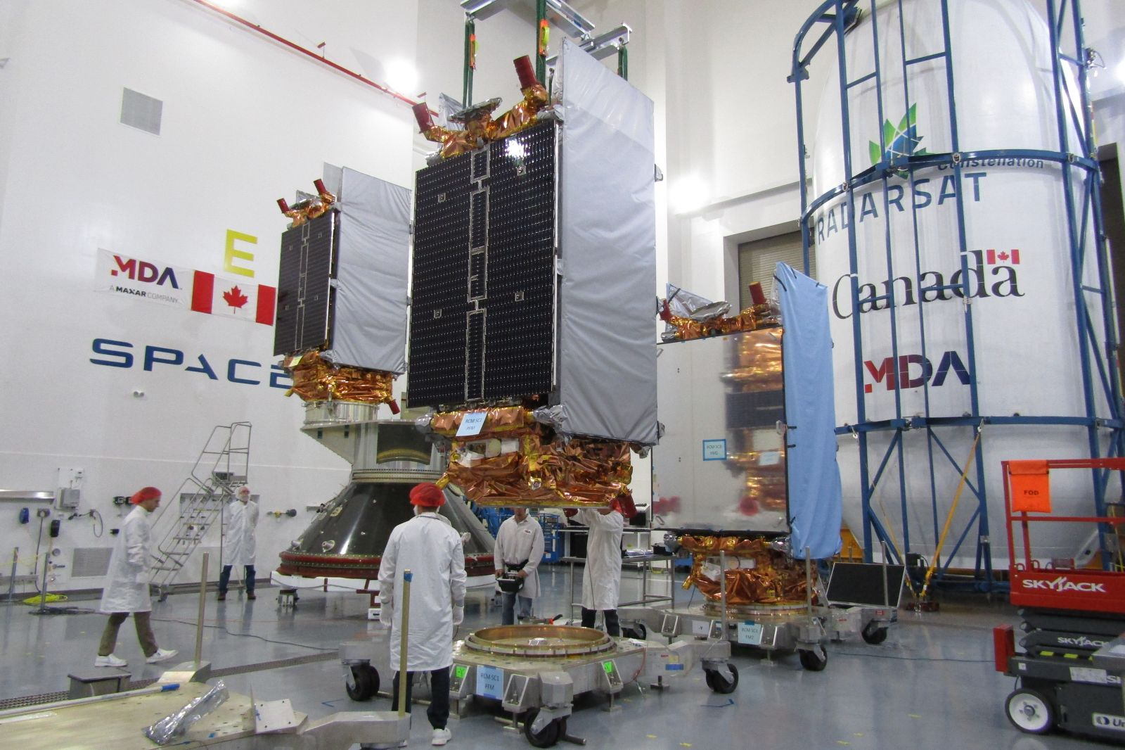 CSA photo of RCM satellites being prepared for flight. Photo Credit: Canadian Space Agency