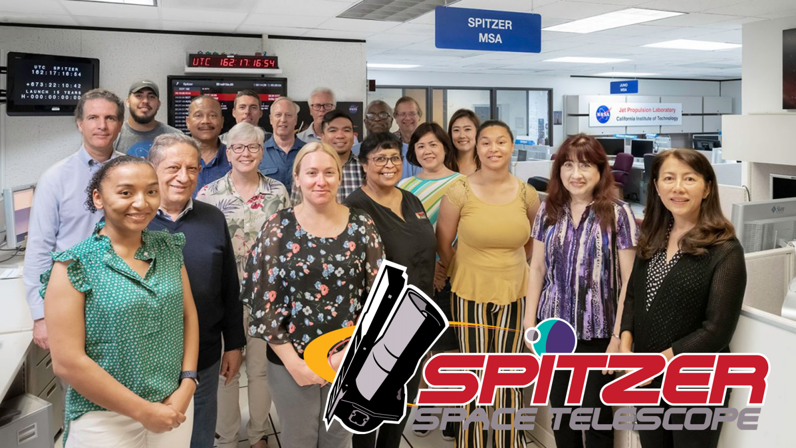 Members of the Spitzer engineering team pose in the mission support area. Front row (left to right): Natalie Martinez-Vlashoff, Jose Macias, Lisa Storrie-Lombardi, Amanda Kniepkamp, Bolinda Kahr, Mariah Woody, Socorro Rangel, May Tran. Middle: Pedro Diaz-Rubin, Joseph Hunt, John Ibanez, Laura Su, Nari Hwangpo. Back row: Michael Diaz, Adam Harbison, Richard Springer, Joe Stuesser, Ken Stowers, Dave Bliss. Not pictured: Bob Lineaweaver, Jason Hitz and Walt Hoffman. Photo Credit: NASA/JPL-Caltech