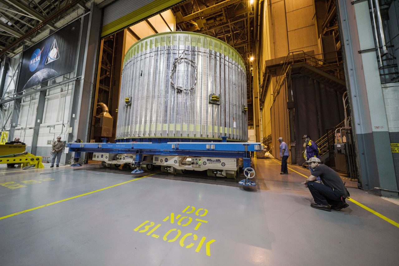 Crews move NASA's Space Launch System rocket's aft liquid oxygen tank (LOX) simulator for practice stacking maneuvers into the Vertical Assembly Building at NASA's Michoud Assembly Facility in New Orleans. Michigan-based supplier Futuramic created the simulator for Boeing, the SLS prime contractor, and NASA. Photo Credit: NASA/Jude Guidry