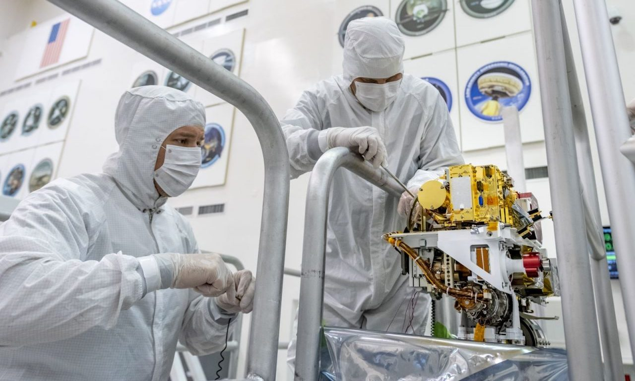 In this photo taken June 25, 2019, engineers install the SuperCam instrument on Mars 2020's rover. Photo Credit: NASA/JPL-Caltech