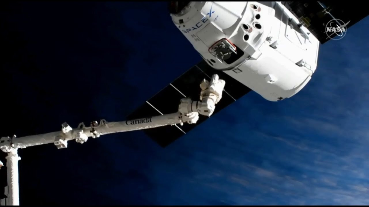 SpaceX's CRS-18 Dragon spacecraft is captured by the Canadarm2 by Expedition 60 crew. Image Credit: NASA