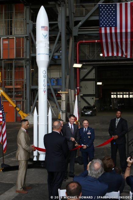 Northrop Grumman Vice President Kent Rominger, with Kennedy Space Center Bob Cabana on his right and Vice Commander of the 45th Space Wing Col. Thomas Ste. Marie on his left, cuts the ribbon in high bay 2. Photo Credit: Michael Howard / SpaceFlight Insider