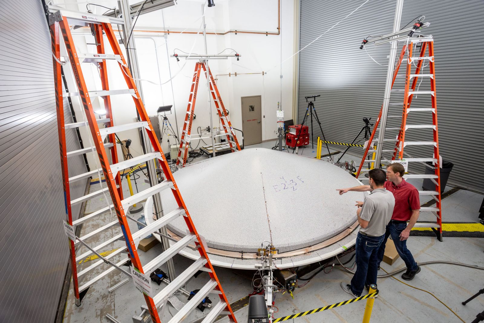 Technicians prepare the aeroshell for a planned July 2020 launch date. Photo Credit: Lockheed Martin