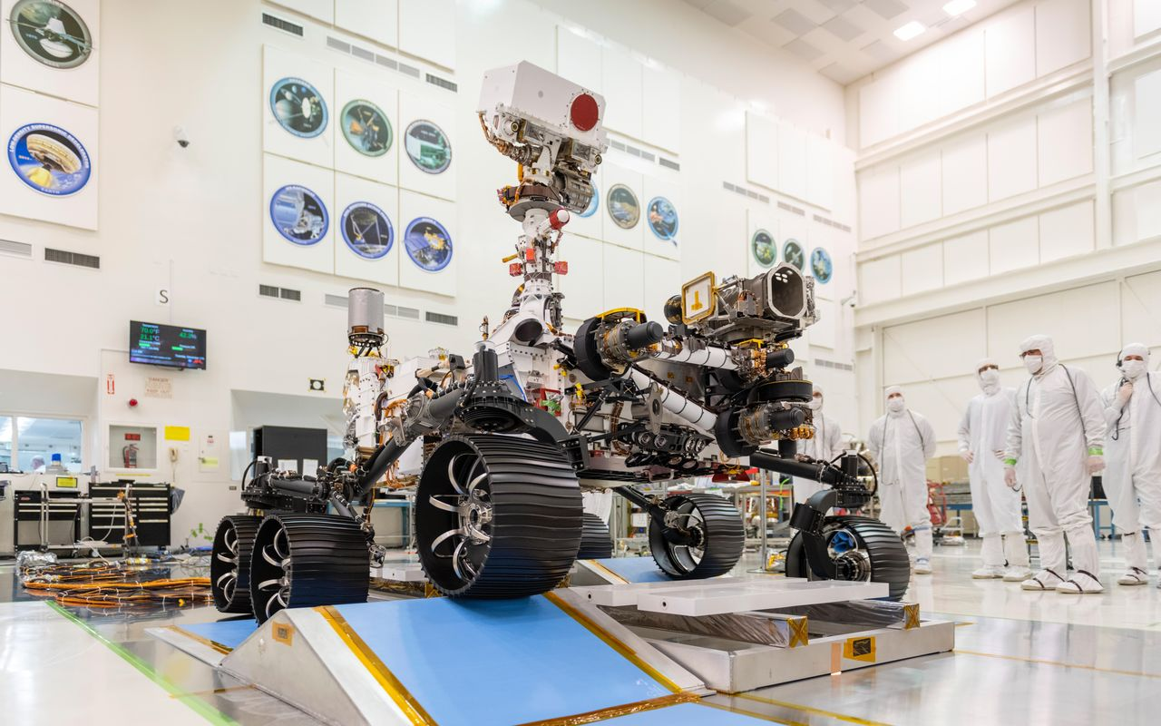 NASA engineers monitor Mars 2020 rover's first driving test in a clean room located In a clean room at NASA's Jet Propulsion Laboratory in Pasadena, California. The test was successfully completed o Dec. 17, 2019. Photo Credit: NASA/JPL-Caltech
