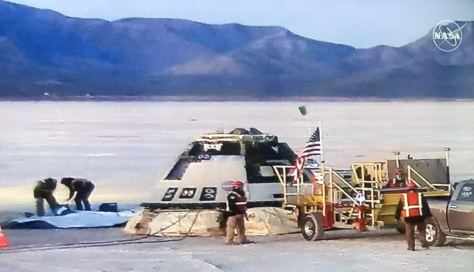 Boeing screen grab from NASA TV coverage of Starliner OFT landing. Image Credit: NASA