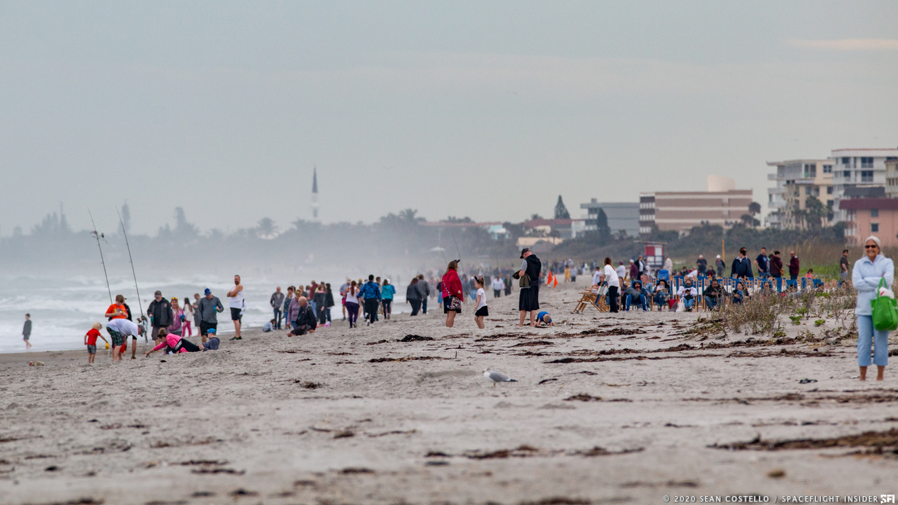 Crowds waited eagerly along the seaside of Cocoa Beach, Fla, on Monday, January 27, hoping to see a Falcon 9 take flight. The rocket successfully launched on January 29, at 9:06am EDT. Image Credit: Sean Costello / SpaceFlight Insider
