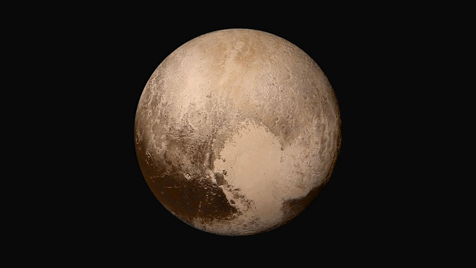 This composite image showing Pluto's heart was created using both black-and-white and color photos captured by New Horizons. Image Credit: NASA/Johns Hopkins University Applied Physics Laboratory/Southwest Research Institute.