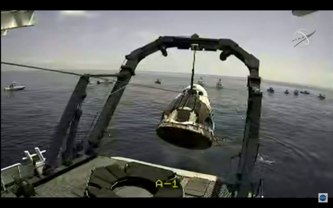 Within a half hour of splashdown, the Crew Dragon spacecraft was brought aboard the recovery vessel. Credit: NASA