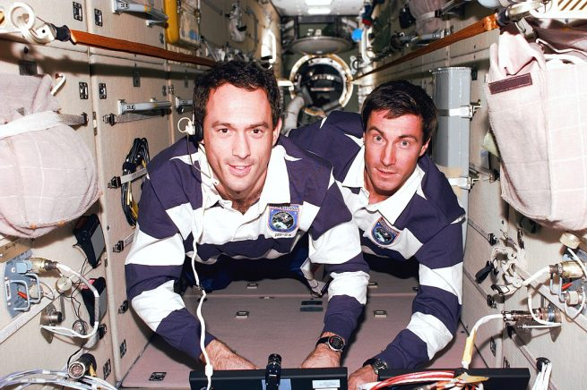 Sergei Krikalev, left, along with NASA astronaut James Newman float inside the Zarya module in December 1998 during the STS-88 space shuttle mission. Credit: NASA
