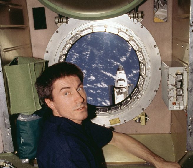 Sergei Krikalev in front of a Zvezda module window while space shuttle Atlantis departs in February 2001. Credit: NASA