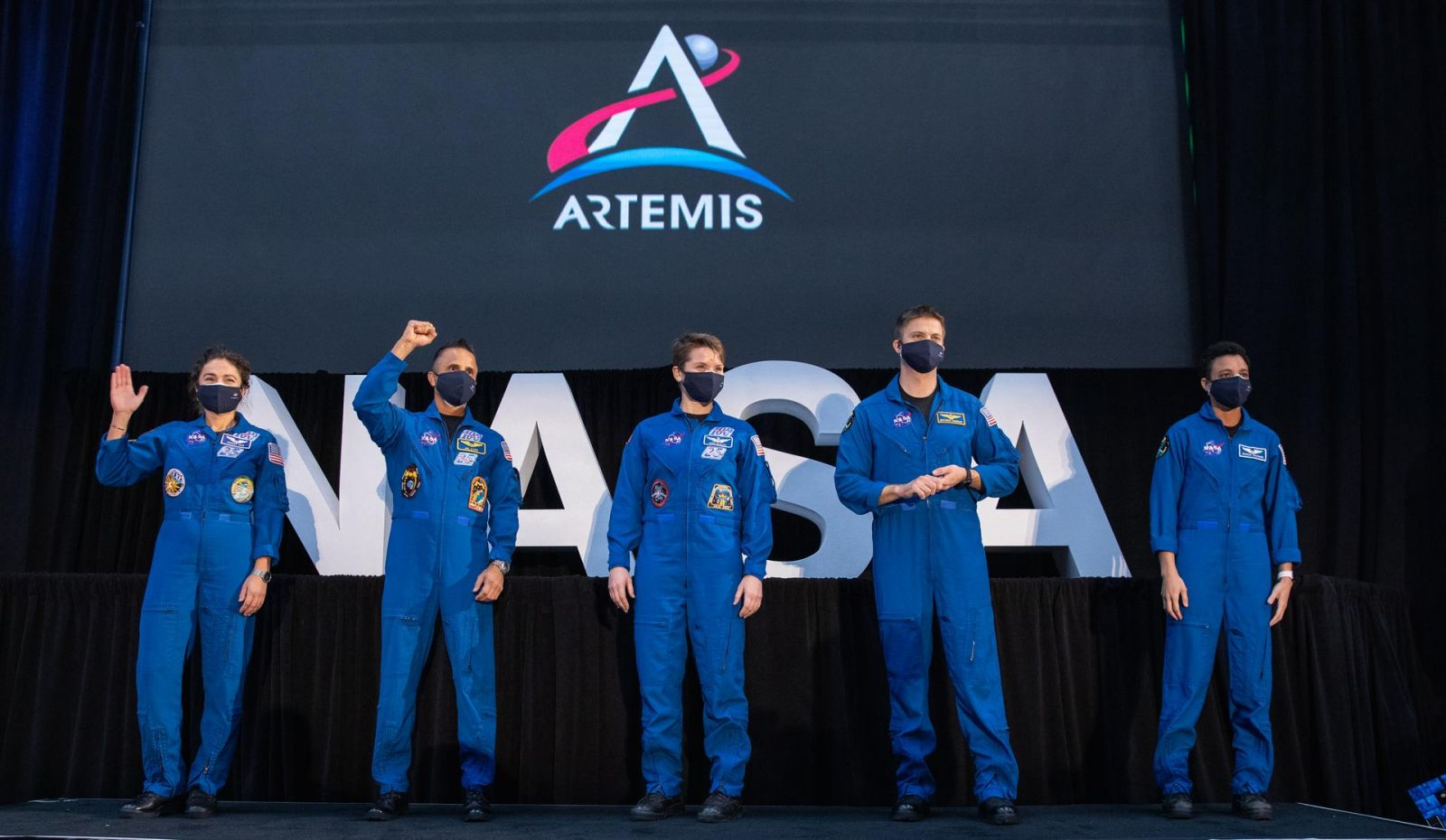"From left to right: NASA astronauts Jessica Meir, Joseph Acaba, Anne McClain, Matthew Dominick, and Jessica Watkins. These astronauts were introduced as part of the 18-member ""Artemis Team"" during a National Space Council meeting inside the Apollo/Saturn V Center at the Kennedy Space Center Visitor Complex in Florida on Dec. 9, 2020. Credit: NASA"