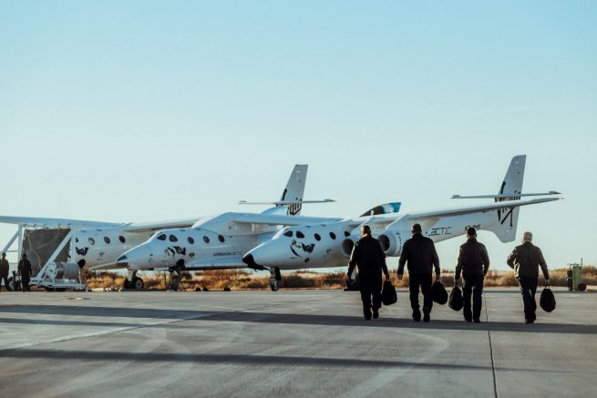 Virgin Galactic Flight test crew walk to the VMS Unity and VMS Eve prior to the aborted test flight. Spaceflight testing crewed vehicles are essential to ensure vehicle safety. Credit: Virgin Galactic