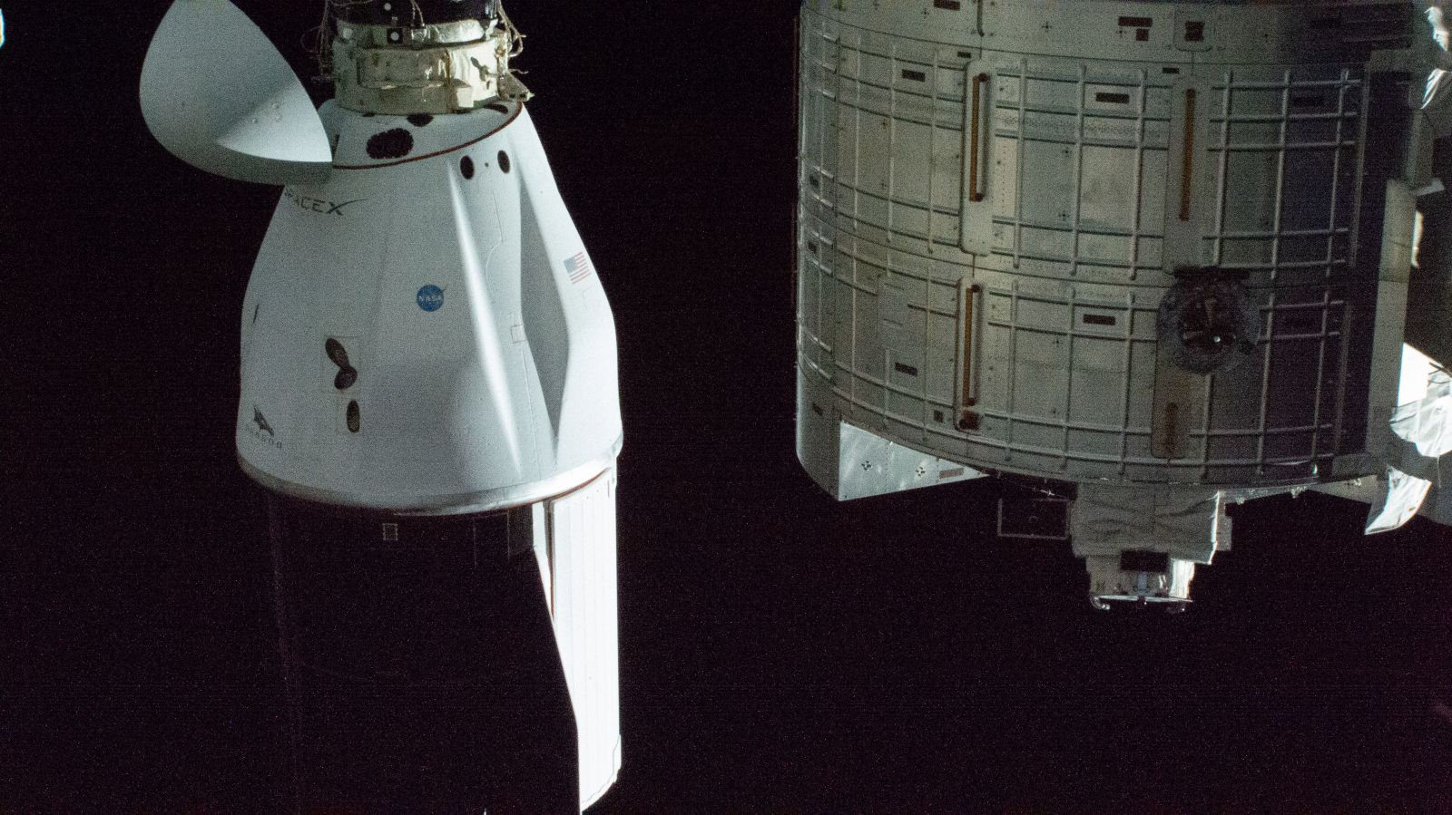 The CRS-21 Dragon spacecraft seen docked to the space-facing port of the Harmony module. Credit: NASA