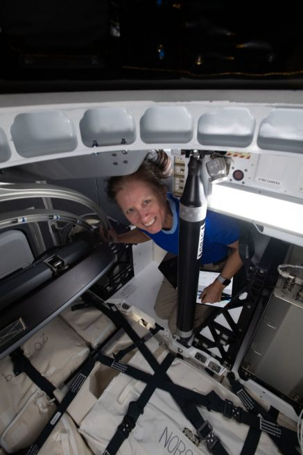 Flight Engineer Shannon Walker loads cargo inside the CRS-21 Dragon in advance of its departure, which took place on Jan. 12, 2021. Credit: NASA