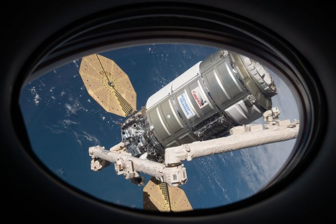 The NG-15 Cygnus spacecraft seen through the window of the Crew-1 Dragon spacecraft shortly after its capture by the robotic Canadarm2. Credit: NASA