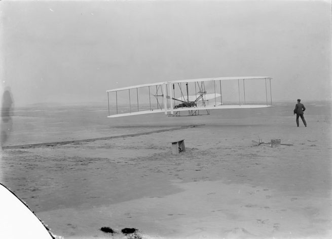 The first powered, controlled flight on Earth was conducted by the Wright Brothers. Orville Wright was at the controls of the Wright Flyer, which made the first, brief flight on Dec. 17, 1903. Credit: Library of Congress