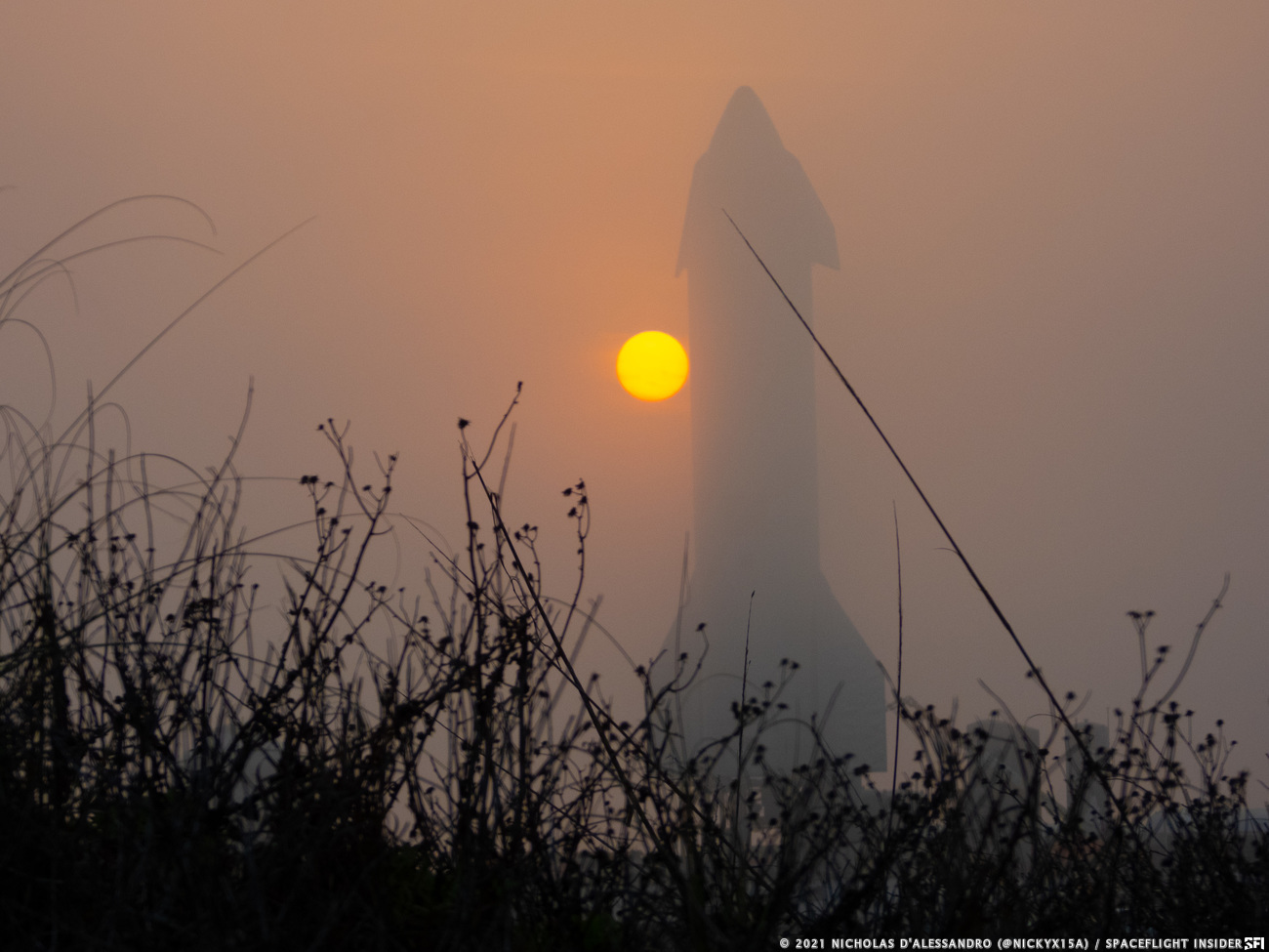 Starship SN10 from the beach dunes under a foggy sunset. Credit: Nicholas D'Alessandro / Spaceflight Insider